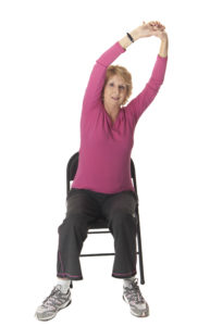 Mature woman stretching cancer exercise training institute